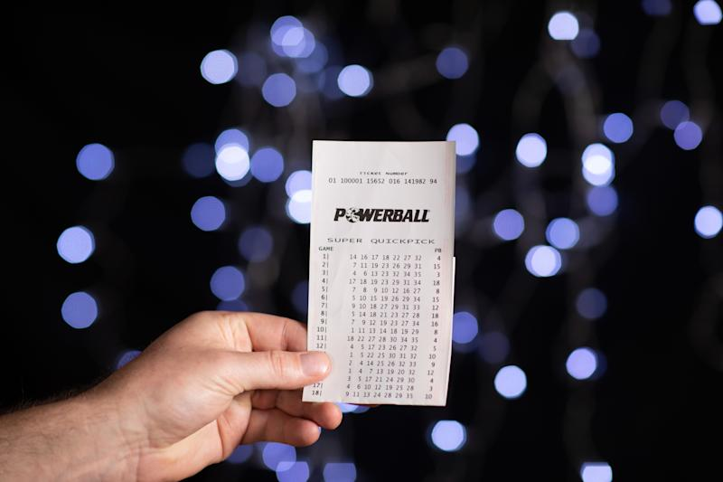 Photo shows Powerball ticket as officials search for the $80 million winner.