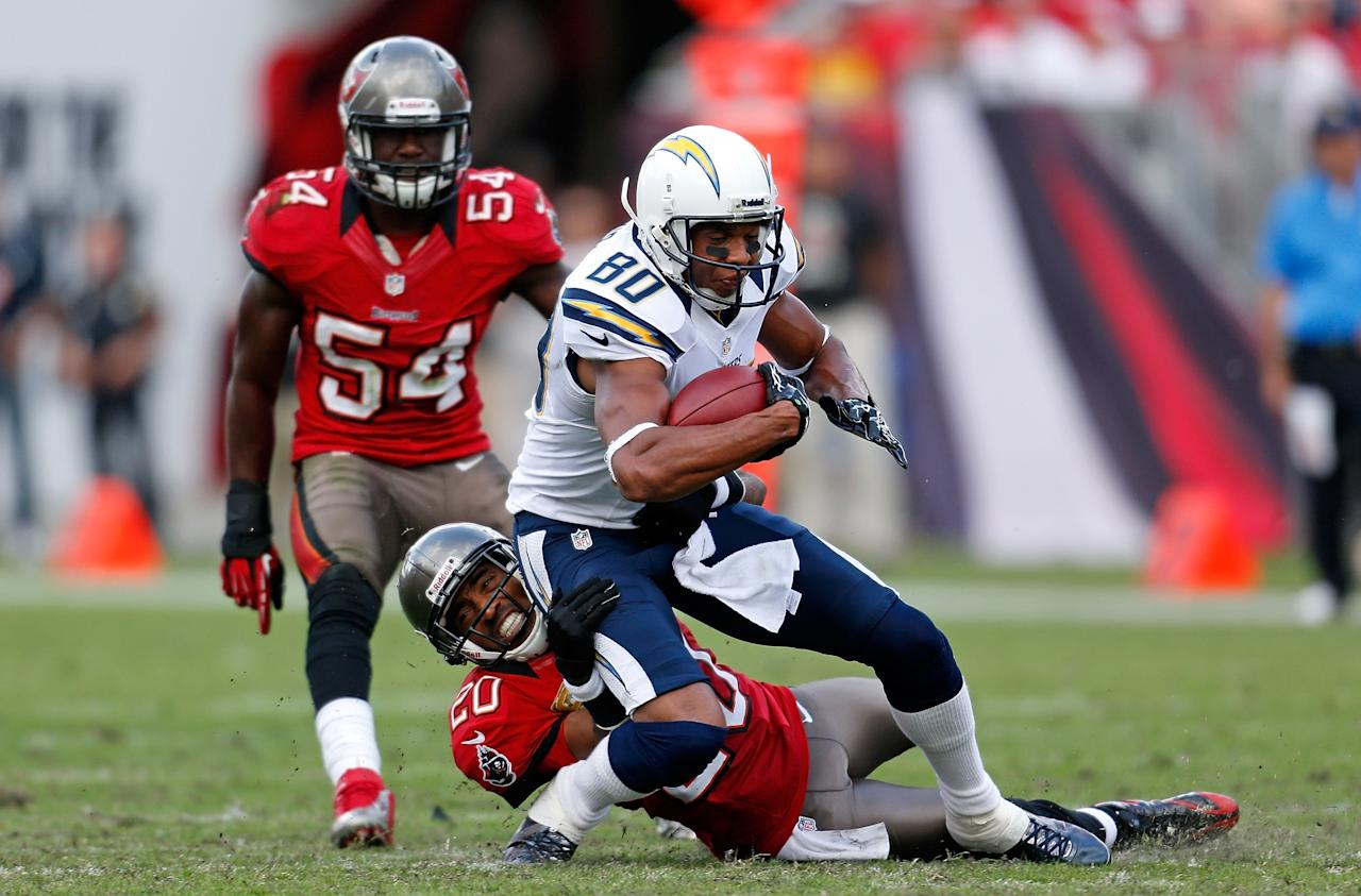 TAMPA, FL - NOVEMBER 11:  Safety Ronde Barber #20 of the Tampa Bay Buccaneers tackles receiver Malcom Floyd #80 of the San Diego Chargers during the game at Raymond James Stadium on November 11, 2012 in Tampa, Florida.  (Photo by J. Meric/Getty Images)