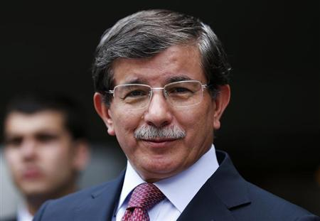 Turkish Foreign Minister Davutoglu addresses the media in Ankara