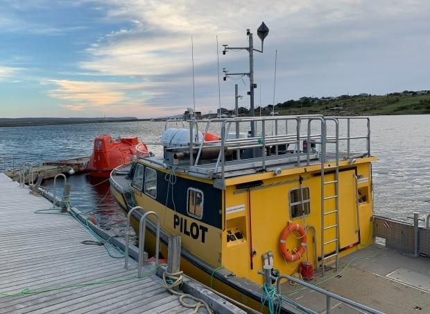 A pilot boat is moored in Long Pond harbour. With aspects of the development still before the court system, there's no timeline on when, or if, the project will become a reality.