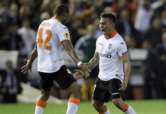 Valencia's Eduardo Vargas from Chile, right , celebrates with teammate Seydou Keita, left, after scoring against Basel, during the Europa League quarterfinal, second leg soccer match at the Mestalla stadium in Valencia, Spain, Thursday, April 10, 2014. (AP Photo/Alberto Saiz)