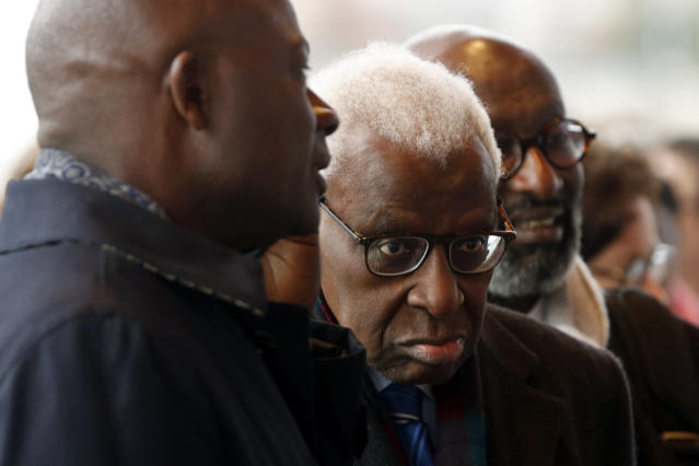 CAPTION CORRECTS SPELLING OF SURNAME Former president of the IAAF (International Association of Athletics Federations) Lamine Diack, center, arrives at the Paris courthouse, Monday, Jan. 13, 2020. One of the biggest sports corruption cases to reach court is being heard in Paris from Monday, with explosive allegations of a massive doping cover-up at the top of track and field. (AP Photo/Thibault Camus)