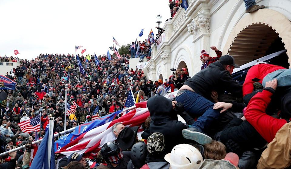 Pro-Trump protesters storm the US Capitol in an effort to halt certification of the 2020 presidential election results on January 6. Photo: Reuters