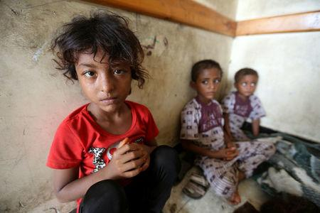 Children sit in a classroom of a school to which they have been evacuated from a village near Hodeidah airport amid fighting between government forces and Houthi fighters in Hodeidah, Yemen
