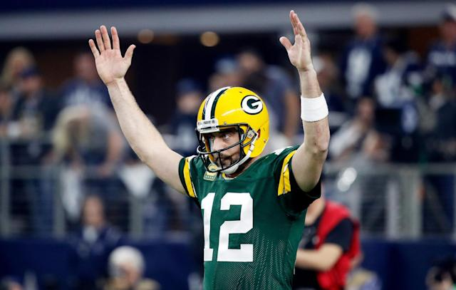 <em>Aaron Rodgers #12 of the Green Bay Packers reacts after scoring a touchdown in the first half during the NFC Divisional Playoff Game against the Dallas Cowboys at AT&T Stadium on January 15, 2017 in Arlington, Texas. (Photo by Joe Robbins/Getty Images)</em>
