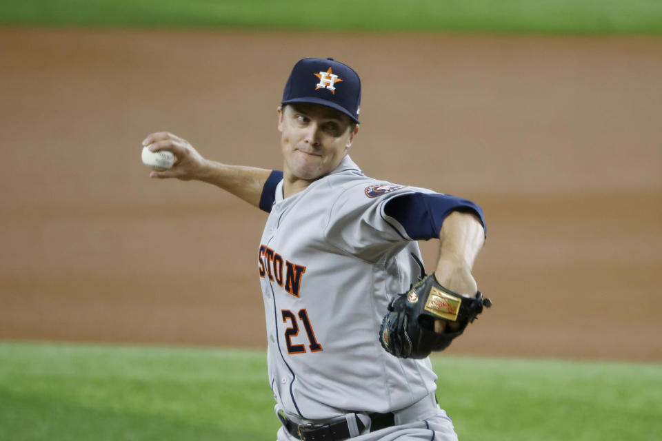 Houston Astros starting pitcher Zack Greinke throws against the Texas Rangers during the first inning of a baseball game Sunday, Aug. 29, 2021, in Arlington, Texas. (AP Photo/Michael Ainsworth)