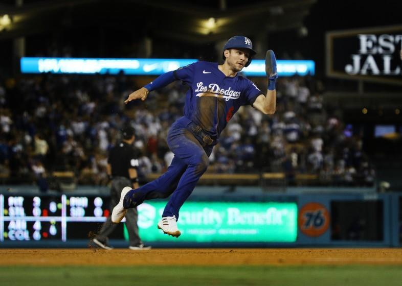 LOS ANGELES, CA - AUGUST 20, 2021: Los Angeles Dodgers second baseman Trea Turner (6) speeds around the bases to score from first base on an RBI double by Los Angeles Dodgers first baseman Max Muncy (13) against the New York Mets in the third inning at Dodger Stadium on August 20, 2021 in Los Angeles, California.(Gina Ferazzi / Los Angeles Times)
