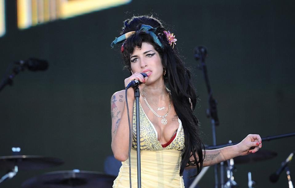 ARGANDA DEL REY, SPAIN - JULY 04:  Amy Winehouse performs on stage during Rock in Rio Day 3 on July 04, 2008 near Madrid in Arganda del Rey, Spain.  (Photo by Carlos Alvarez/Getty Images)