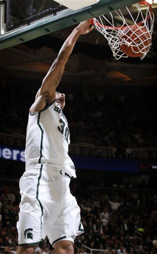 Michigan State's Brandon Wood slams down a dunl on a fast break during the second half of an NCAA college basketball game against Indiana on Wednesday, Dec. 28, 2011, in East Lansing, Mich. Michigan State won 80-65. (AP Photo/Al Goldis)
