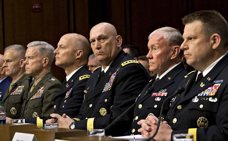 As Congress investigates the growing epidemic of sexual assaults within the military, the Senate Armed Services Committee holds a hearing on Capitol Hill in Washington, Tuesday, June 4, 2013, to demand answers from top uniformed leaders about whether a drastic overhaul of the military justice system is needed. Fro right to left are: Legal Counsel to the Chairman of the Joint Chiefs of Staff Brig. Gen. Richard C. Gross, Joint Chiefs Chairman Gen. Martin Dempsey, Army Chief of Staff Gen. Ray Odierno, Judge Advocate General of the Army Lt. Gen. Dana K. Chipman, Commandant of the Marine Corps Gen. James F. Amos, and Staff Judge Advocate to the Marine Corps Commandant Maj. Gen. Vaughn A. Ary. (AP Photo/J. Scott Applewhite)