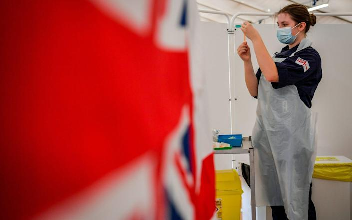 Royal Navy personnel prepare to give Covid jabs to the public at a vaccination centre set up at Bath Racecourse - Ben Birchall/PA