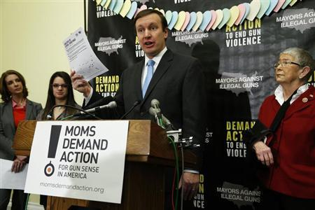 U.S. Senator Murphy speaks at a news conference held by the groups Mayors Against Illegal Guns and Moms Demand Action for Gun Sense in America, in Washington