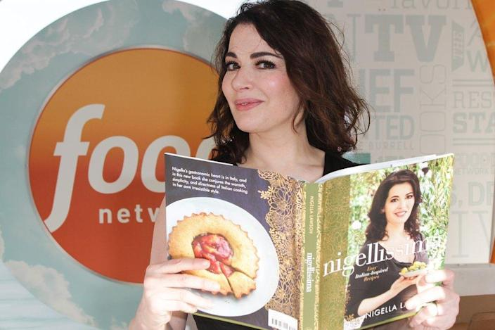 Nigella Lawson with one of her multiple cook books