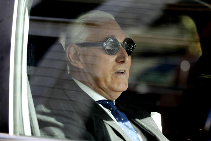 Roger Stone sits in a vehicle while leaving federal court in Washington on Friday. (Photo: Julio Cortez/AP)