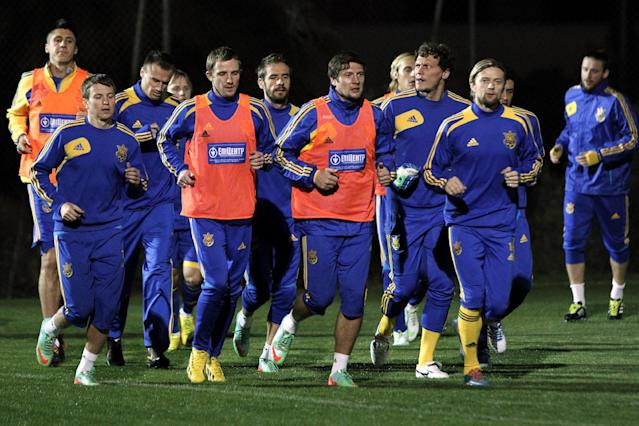 Ukrainian national soccer team players warm up during a training session at the Ayia Napa resort, southeastern Cyprus, Thursday, March 4, 2014. Ukraine will face the United States in a friendly soccer match on Wednesday in Cyprus, after the match was moved from Kharkiv, Ukraine to Larnaca for security reasons. (AP Photo/Petros Karadjias)