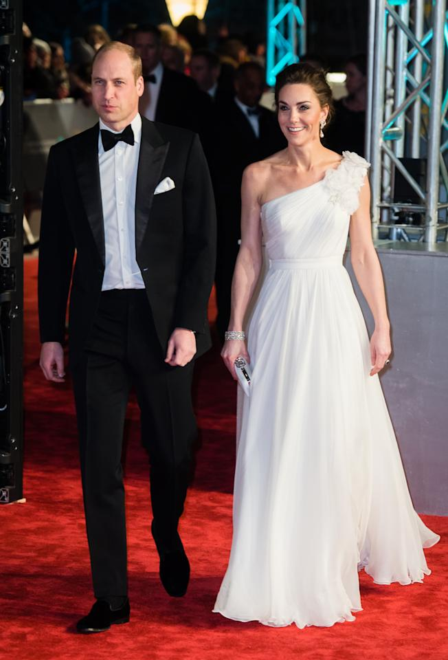 The Duchess of Cambridge wore a beautiful, bespoke, one-shoulder gown by Alexander McQueen for the annual red carpet event, while the Duke looked dapper in a traditional tux. <em>[Photo: Getty]</em>