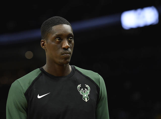 MILWAUKEE, WISCONSIN - APRIL 06: Tony Snell #21 of the Milwaukee Bucks looks on from the bench in the second half against the Brooklyn Nets at Fiserv Forum on April 06, 2019 in Milwaukee, Wisconsin. (Photo by Quinn Harris/Getty Images)