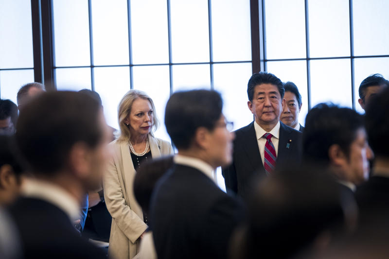 Japan's Prime Minister Shinzo Abe, center right, and Mary Jean Eisenhower, center left, granddaughter of former U.S. President Dwight Eisenhower attend the 60th anniversary commemorative reception of the signing of the Japan-US security treaty at Sunday, Jan. 19, 2020. (Behrouz Mehri/Pool Photo via AP)
