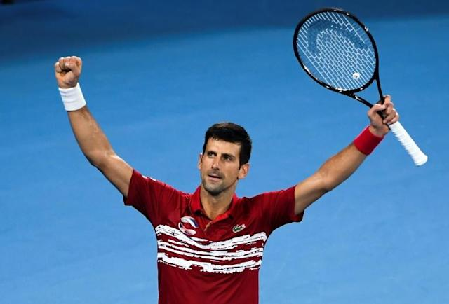 Novak Djokovic of Serbia celebrates after beating Rafael Nadal of Spain in their men's singles match at the ATP Cup team tennis tournament in Sydney (AFP Photo/William WEST)