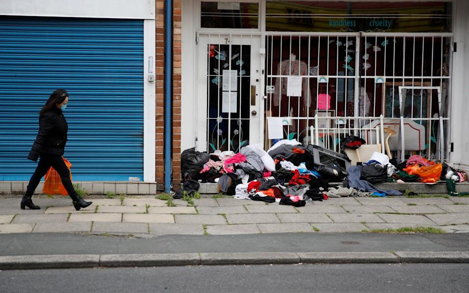 A pile of items left outside a charity shop in Urmston, Greater Manchester, last year - REUTERS
