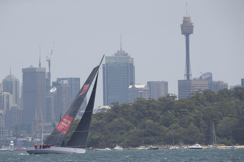 Wild Oats XI heads up Sydney Harbour during the start of the Sydney Hobart yacht race in Sydney, Australia, Thursday, Dec. 26, 2019. (AP Photo/Steve Chirsto)