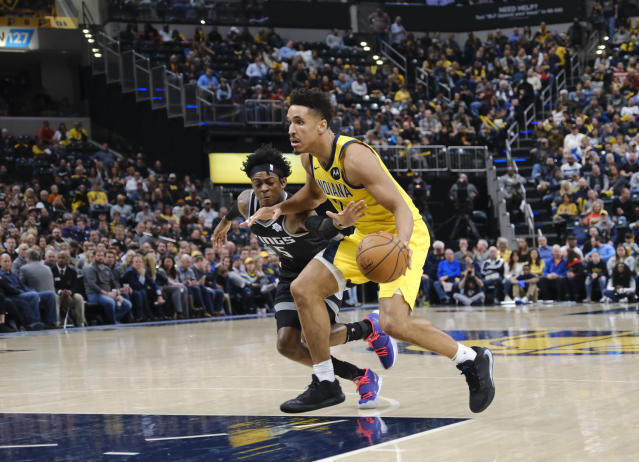 Indiana Pacers guard Malcolm Brogdon (7) is defended by Sacramento Kings forward Marvin Bagley III (35) during the second half of an NBA basketball game in Indianapolis, Friday, Dec. 20, 2019. The Pacers won 119-105. (AP Photo/AJ Mast)