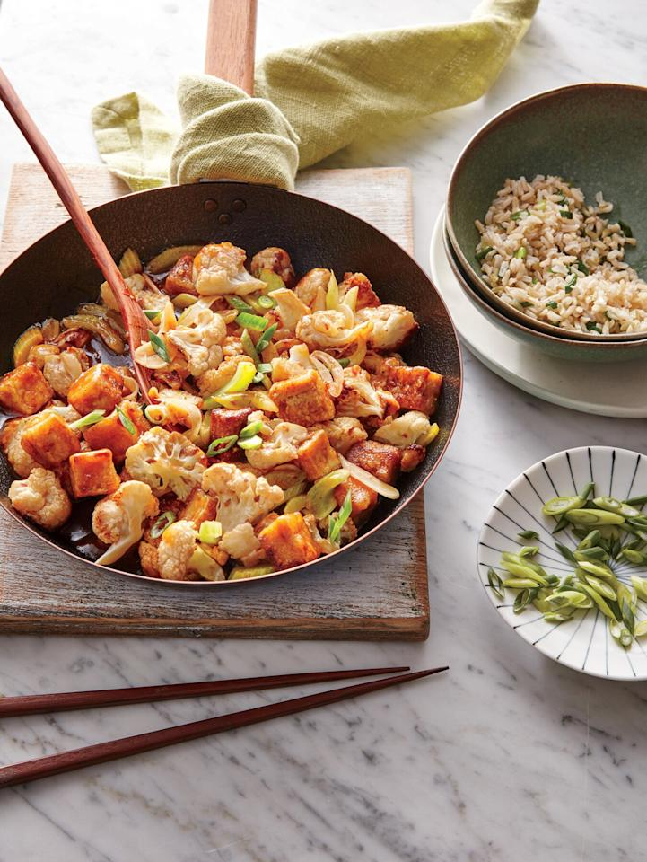 """<p>This 25-minute meal will have you tossing out your Chinese take-out menu.</p> <p> <a href=""""https://www.cookinglight.com/recipes/szechuan-tofu-cauliflower"""">View Recipe: Szechuan Tofu with Cauliflower</a></p>"""