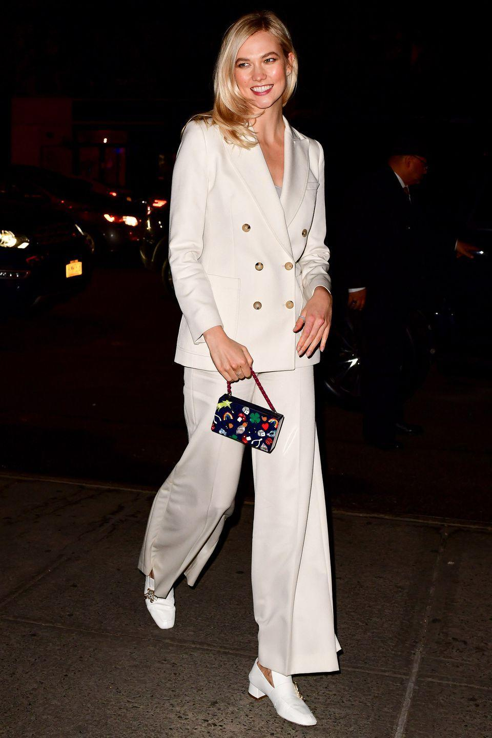 <p>Karlie Kloss might be headed out for the evening but this chic white trouser suit will work day to night. The fit is loose so you won't get too warm, but you're still covered up (because it's not quite beach weather yet).</p>
