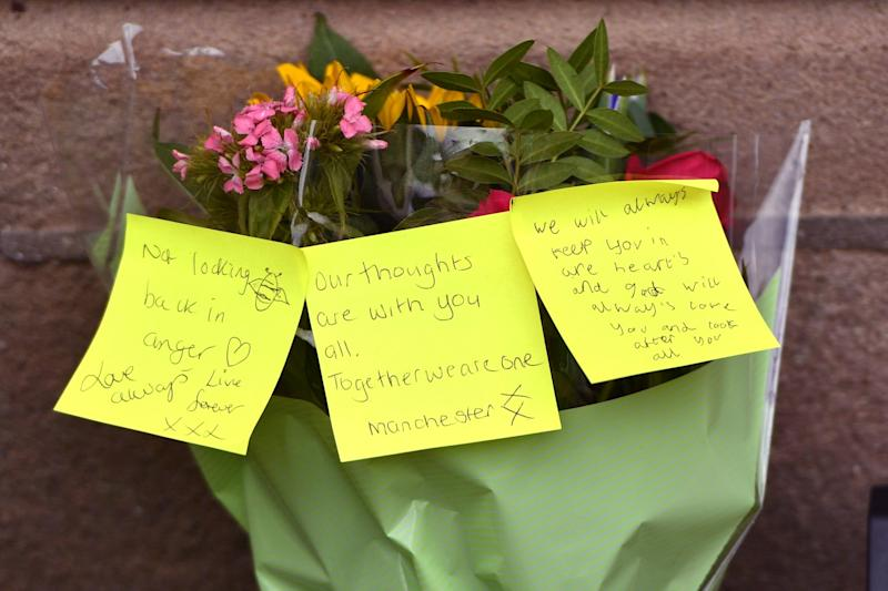 Flowers are left outside the Cathedral as members of the public pay tribute to the victims (Getty Images)