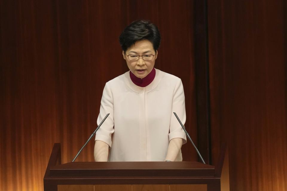 Hong Kong Chief Executive Carrie Lam delivers her policies at the chamber of Legislative Council in Hong Kong, Wednesday, Oct. 6, 2021. Lam announced a major development plan Wednesday for Hong Kong's border area with mainland China in the last annual policy address of her current term. (AP Photo/Kin Cheung)