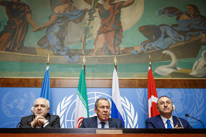 From left to right: Iranian Foreign Minister Mohammad Javad Zarif, Russian Foreign Minister Sergei Lavrov and Turkish Foreign Minister Mevlut Cavusoglu attend a press conference a day prior to the Syrian Constitutional Committee meeting in Geneva, at the European headquarters of the United Nations in Geneva, Switzerland, Tuesday, Oct. 29, 2019. Representatives from the Syrian government, opposition and civil society are to begin meeting in Geneva on Wednesday. (Valentin Flauraud, Keystone via AP)