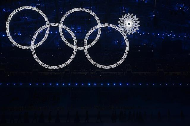 Snowflakes transform into four Olympic rings with one failing to form during the Opening Ceremony of the Sochi 2014 Winter Olympics. (Getty)