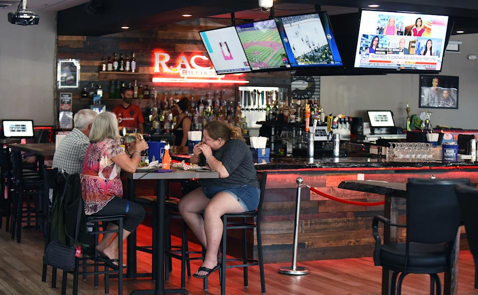 SANFORD, UNITED STATES - MAY 04, 2020: Customers enjoy a meal at Racks Billiards Sports Bar and Grill on the first day that retail stores and restaurants in all Florida counties except Palm Beach, Broward, and Miami Dade were permitted to reopen as COVID-19 restrictions are eased. Under phase one of the plan to reopen the state, stores and restaurants are limited to 25 percent of their indoor capacity.- PHOTOGRAPH BY Paul Hennessy / Echoes Wire/ Barcroft Studios / Future Publishing (Photo credit should read Paul Hennessy / Echoes Wire/Barcroft Media via Getty Images)