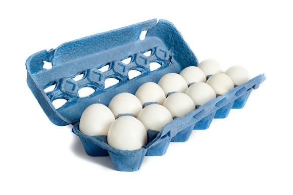 Dozen white eggs in a blue carton.