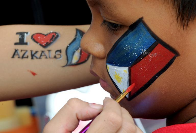 In this file photo, a young supporter of the Philippines team has his face painted with the national flag, ahead of their 2014 FIFA World Cup qualifying match against Sri Lanka, in Manila, on July 3, 2011