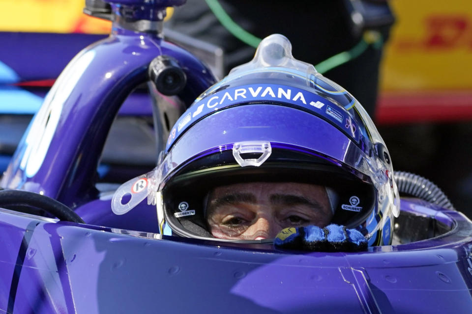 FILE - In this May 14, 2021, file photo, Jimmie Johnson climbs out of his car following practice for the IndyCar auto race at Indianapolis Motor Speedway in Indianapolis. Johnson is hopeful of testing in August at Homestead-Miami Speedway as part of a path toward running in the Indianapolis 500 in 2022. The seven-time NASCAR champion jumped this season to IndyCar and has competed in seven races for team owner Chip Ganassi. (AP Photo/Darron Cummings, File)