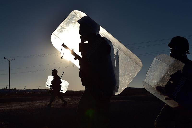 Turkish troops patrol along the Turkish border with Syria near the city of Sanliurfa on October 4, 2014