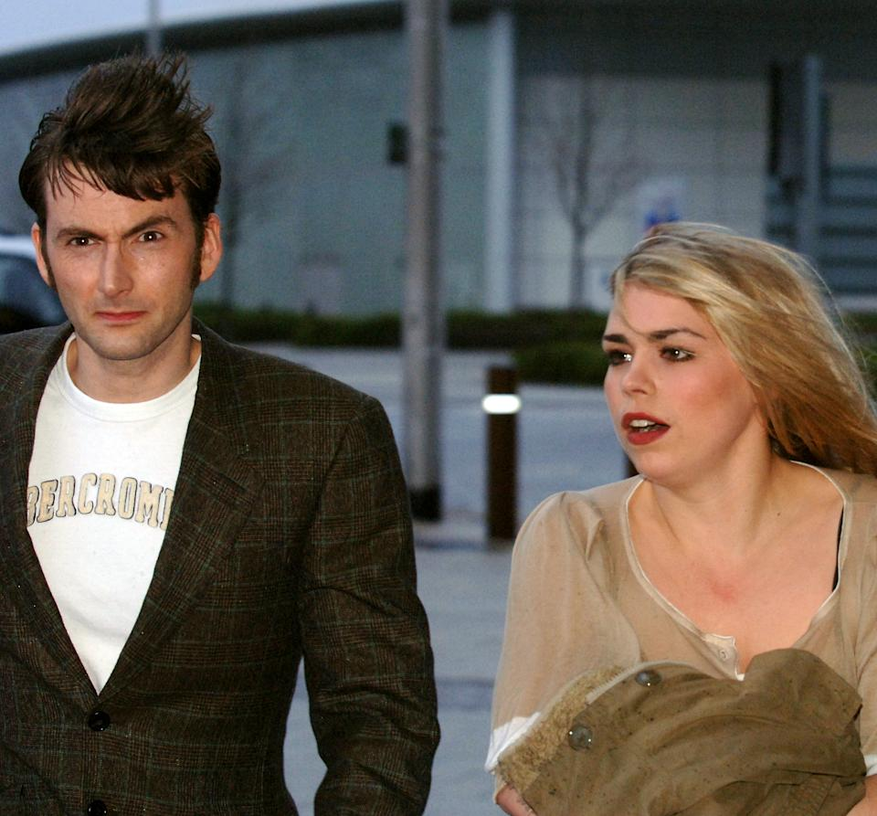 Dr Who stars David Tennant and Billie Piper arrive for the media screening at the Millennium Centre in Cardiff, Tuesday March 28, 2006. Tennant, 34, whose recent credits include Casanova and Blackpool, has taken over the role from Christopher Eccleston and has already starred in a Christmas special. See PA Story SHOWBIZ Who. PRESS ASSOCIATION Photo. Photo credit should read: Barry Batchelor/PA. (Photo by Barry Batchelor - PA Images/PA Images via Getty Images)