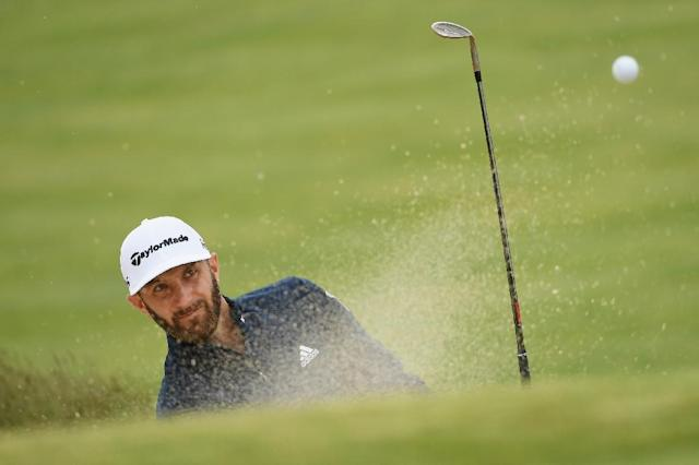Dustin Johnson of the US plays a shot from a bunker on the 11th hole during a practice round prior to the 2018 US Open, at Shinnecock Hills Golf Club in Southampton, New York, on June 13 (AFP Photo/ROSS KINNAIRD)