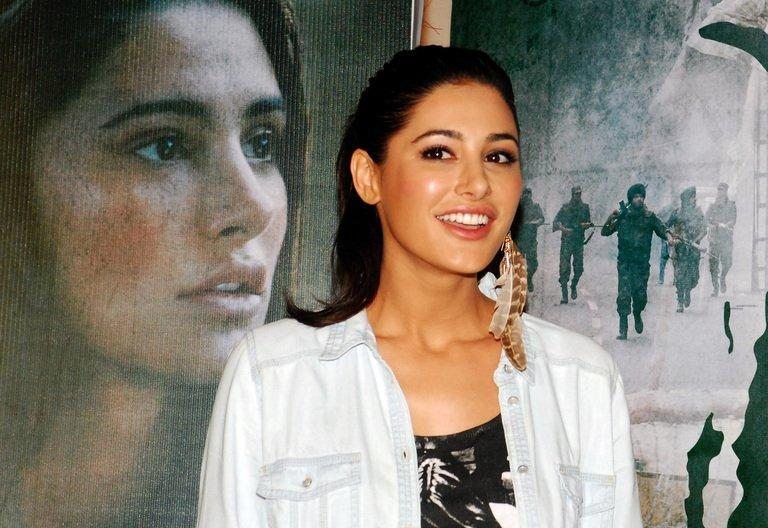"""Indian Bollywood actor Nargis Fakhri attends a screening of """"Madras Café"""" in Mumbai on July 11, 2013. The Bollywood spy thriller set against the backdrop of the Sri Lankan civil war has been pulled from British and some Indian theatres after protests over its depiction of rebel fighters"""