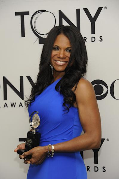 """Audra McDonald poses backstage with her award for best actress in a musical for her role in """"The Gershwins' Porgy and Bess"""" at the 66th annual Tony Awards on Sunday June 10, 2012, in New York. (Photo by Evan Agostini /Invision/AP)"""