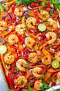 """<p> Plump, juicy, and tender shrimp that's ready in 25 minutes? That's what these <a href=""""http://www.averiecooks.com/sheet-pan-shrimp-fajitas/"""" class=""""link rapid-noclick-resp"""" rel=""""nofollow noopener"""" target=""""_blank"""" data-ylk=""""slk:shrimp fajitas"""">shrimp fajitas</a> are all about! </p>"""