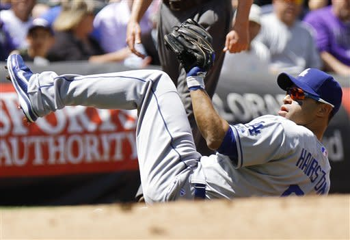 Los Angeles Dodgers third baseman Jerry Hairston Jr. (6) makes a diving catch on a line drive by Colorado Rockies' Jonathan Herrera during the first inning of a baseball game, Wednesday, May 2, 2012, in Denver. (AP Photo/Barry Gutierrez)