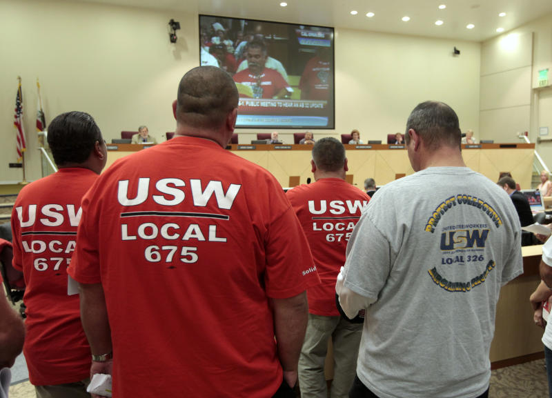 Members of the United Steel Workers in joined dozens of others calling for the California Air Resources Board to reconsider the state's pending cap-and-trade program for carbon emissions, during a hearing Thursday, Sept. 20, 2012, in Sacramento, Calif. The board took testimony from experts and the public on the the cost to businesses and consumers with the implementation of AB32, California's landmark greenhouse gas emissions law. (AP Photo/Rich Pedroncelli)