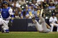 Pittsburgh Pirates' Adam Frazier, right, falls to the ground to avoid being hit by a pitch during the seventh inning of the team's baseball game against the Milwaukee Brewers on Friday, Sept. 20, 2019, in Milwaukee. (AP Photo/Aaron Gash)