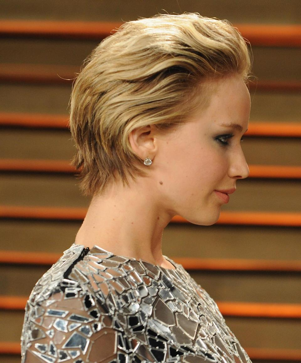 <p>At the 2014 Oscars, Jennifer Lawrence's hair was so short that styling it wasn't really an option. Instead, the star swept it back and teamed it with smokey eye make-up. [Photo: Getty] </p>