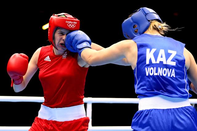 LONDON, ENGLAND - AUGUST 06: Marina Volnova of Kazakhstan (Blue) competes against Savannah Marshall (Red) of Great Britain during the Women's Middle (75kg) Boxing Quarterfinals on Day 10 of the London 2012 Olympic Games at ExCeL on August 6, 2012 in London, England. (Photo by Scott Heavey/Getty Images)