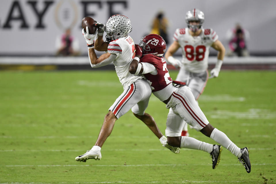 Ohio State WR Chris Olave, left, showed well in the national-title loss to Alabama. (Photo by Alika Jenner/Getty Images)