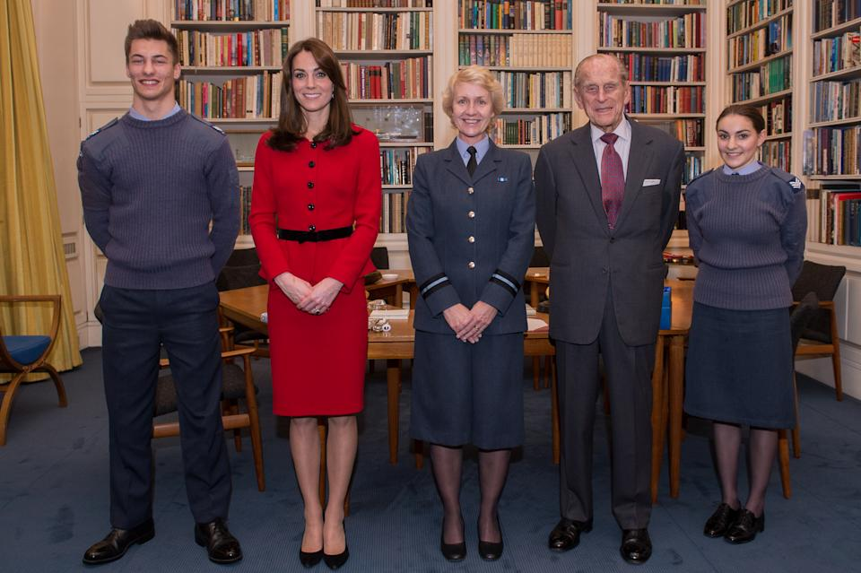 Cadet Sergeant Tommy Dade (far left) and Cadet Sergeant Bronwyn Jacobs (far right) stand with the Duke of Edinburgh (second right) as he meets Air Commodore, Dawn McCafferty, Commandant of the Air Cadet organisation (centre) at Buckingham Palace in London, as he retired from the post of Air Commodore in Chief and on the occasion of the Duchess of Cambridge (second left) becoming Honorary Air Commandant of the Air Cadets.