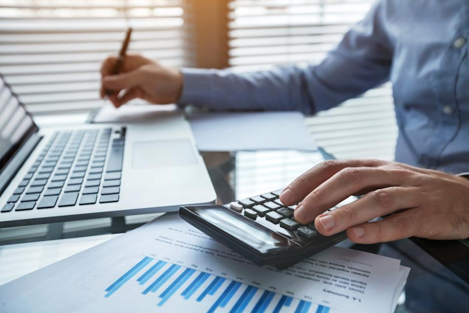 finance and investment, accounting, calculating taxes, corporate financial report of company